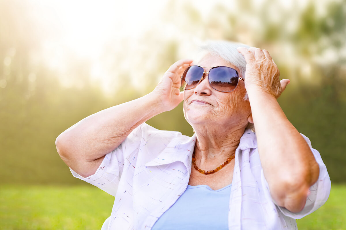 senior woman wearing sunglasses outside_importance of eye health and aging